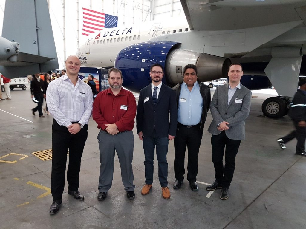 """(From Left) CEO, Jason Pottinger, CTO, Frank Oliver, Dr. Travis Desell (inventor) and members of the Predictive Aviation Analytics team meet with Delta Air Lines to discuss a strategic partnership."